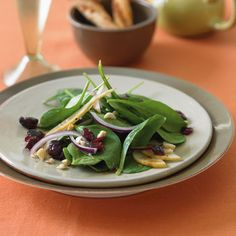 Spinach Salad with Bosc Pears, Cranberries, Red Onion, and Toasted Hazelnuts