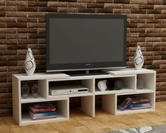 With open shelves and straight cabinetry options, a TV unit offers lots of storage space for things that can cause clutter in the living space. Organize properly with our CARE White TV Unit for only $191.52!  Tags: #doseofmodern #furniture #furnituredesign #furniturejepara #furniturejakarta #furnituremurah #furniturebandung #furnituresurabaya #furniturebali #furnitureonline #furnitureindonesia #furnitureminimalis #furnituremaker #furniturestore #furnitures #furnituremedan #furnituremodern… Tv Unit Furniture, Online Furniture, Modern Furniture, Furniture Design, White Tv Unit, Tv Unit Design, Tv Cabinets, Open Shelving, Storage Spaces