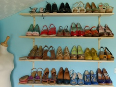 On the wall to the right of the door I have extra shelving, which is currently holding (some of) my shoe collection.     Comfortable & Beautifull Collection of Shoes at a Bargain.http://jeelis.com/Shoes