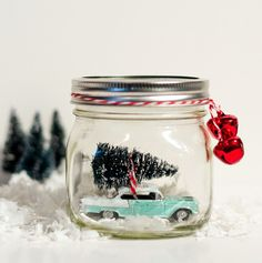 Pin for Later: 14 Creative Ways to Decorate With Mason Jars For the Holidays Tree-Cutting Keepsake Linda from It All Started With Paint memorialized the excitement of buying a Christmas tree with this adorable retro-inspired snow globe.