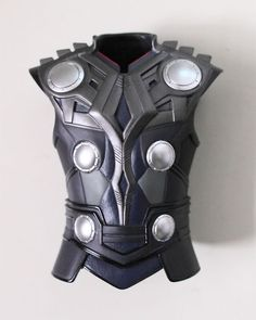 Alexandra Byrne 2011 Thor's tunic This is a close-up image of tunic of the costume, it shows the fine detail in the design of how the different part all come together as a whole. I like it because of the differences in colour from the bright silver to the great and dark blue.