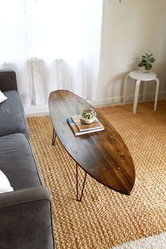A unique surfboard coffee table hand shaped from douglas-fir and stained in dark walnut, many color options available. Please see the drop down