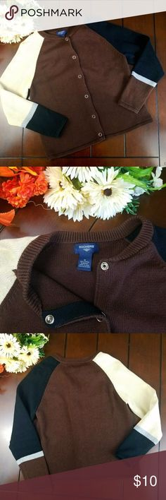 Dockers Snap Button Sweater This casual color block sweater is available pre-loved in size medium. There are no holes no tears and no stains. Features 6 snap button placket and crew neck. 100% cotton. Machine washable. Brown / black / tan / Grey Dockers Sweaters Cardigans