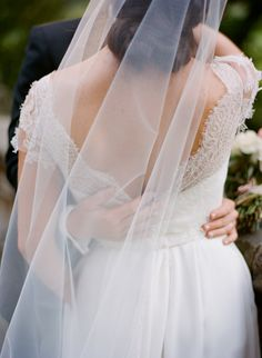 The back of Jamie Beck's wedding dress. Lovely. [ann street stuido]