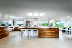 Kitchen countertop in Arctic White Neolith with custom full height Calacatta marble backsplash. Cabinets by Jason Good Custom Cabinets. Photograph by Joshua Lawrence Studios Inc.
