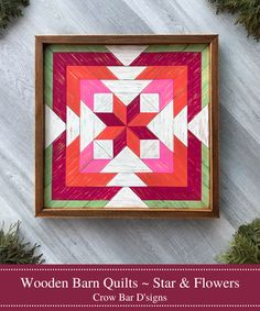 This handmade wooden barn quilt features a star and flower quilt block pattern. Each individual piece of cedar wood is hand painted and lightly distressed to give the piece a rustic charm and vintage feel. The vibrant colors include Flamingo Coral, Magenta, Fuchsia Pink, Spring Green, and Off-White. It is framed with more cedar and is ready for display on any wall space in your home. Add color, texture, and design to your living room or bedroom with a handmade wood barn quilt. Barn Quilt Designs, Quilting Designs, Mosaic Wall Art, Wood Wall Art, Wooden Barn, Rustic Wall Decor, Wall Spaces, Pattern Blocks, Handmade Wooden