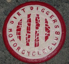 Dirt Diggers Mosaic Stepping Stone - Materials used are white and red tiles. I painted the words on white tiles with outside paint that was baked on. Made especially for my brother.