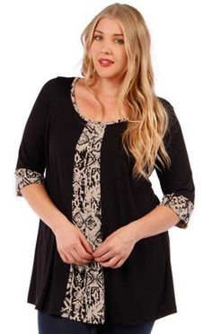 Women's Plus Size Print and Solid Color Top Self: 79% Polyester 18% Rayon 3% Spandex Contrast: 95% Polyester 5% Spandex