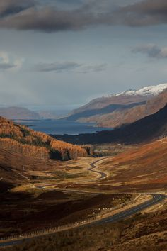 Loch Maree from the top of Glen Docherty with brown hills and snow on the mountain tops - a sunny late autumn or winter day.