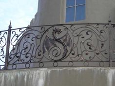 Wrought iron Dragon fence.