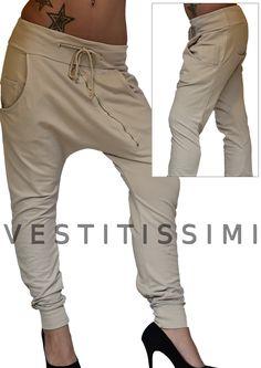 Pantalone donna sportivo colore beige con tasche, lacci in vita e cerniera obliqua