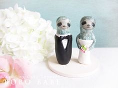 Whoever eventually agrees to marry me will have to be okay with these sloth wedding cake toppers...