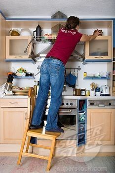 """Stock Photo #1848-148857, Household accidents, girl standing on a chair in the kitchen, tilting, Phill; Bend and stretch soon you will see """"STARS"""""""