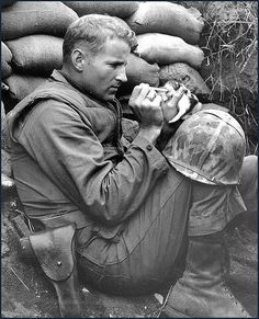 WWII,1943; Marine nurses a kitten.  Some things never change. <3