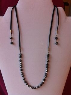 'Black faux suede lariat style necklace' is going up for auction at  4pm Mon, Jan 7 with a starting bid of $5.