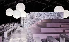 Carven: Bureau Betak filled Paris' Espace Éphémère des Tuileries with slabs of grey-veined white marble, a lilac-hued pyramid of seating and large balloon-like bubble lamps for Carven's sugary sweet A/W 2016 show set Stage Design, Event Design, Alexandre De Betak, Bureau Betak, Catwalk Design, Tuileries Paris, Fashion Wallpaper, Wallpaper Magazine, Stage Set