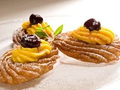 When served with pastry cream, these famous Neapolitan fritters are truly irresistible.