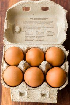 6 local organic, non-GMO, pasture-raised eggs in a recycling carton in Vienna.