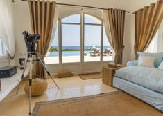 Errikos Kohls Premium Rental Services is a specialised agency based on the island of Paros that offers a variety of premium properties. Villas, Living Area, Living Room, Kohls, Relax, Curtains, Home Decor, Real Estates, Blinds