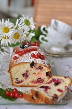 sugar dusted Red and Black Currant Loaf Cake.