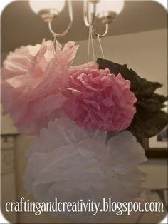 Tissue Paper Pom Poms 5.13 Totally easy! Rounded the edges on one and scalloped the edges on the other. Both turned out cute!