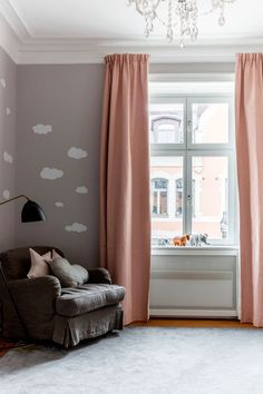 Lovely apartment with pink accents in Sweden #wallpaper #clouds #window #curtaine #arm #chair #kids #room #idea