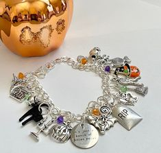 Excited to share this item from my #etsy shop: Just a Bunch of Hocus Pocus Charm Bracelet Halloween Bracelet Skull Pumpkin, Gift For Music Lover, Halloween Earrings, Jewelry Polishing Cloth, Hocus Pocus, Organza Bags, Green And Purple, Handmade Bracelets, Crystal Beads