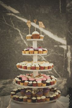 Cupcake Tower with State Cake Toppers | Pazzo's | Color&Cake Photography | http://www.theknot.com/submit-your-wedding/photo/796eed31-b9b4-40a0-a2eb-9b19c46621e3/Winter-Wedding-in-Chicago