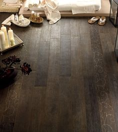 Ceramic tile that looks like wood.....perfect for a kitchen, bathroom, or basement. The beauty of wood with the ease of ceramic- and no grout lines!
