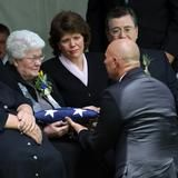 Elder Boyd K. Packer funeral and gravesite on July 10, 2015. US flag presented to the widow on the same day the flag of the confederacy was removed, by an act of the South Carolina state senate, from flying over the state's capitol building following the deaths by murder of the Charleston Nine. Any symmetry there?