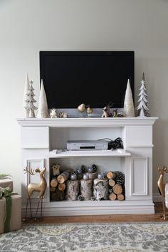 manteau de cheminée artisanal en meuble de télé avec de multiples rangements