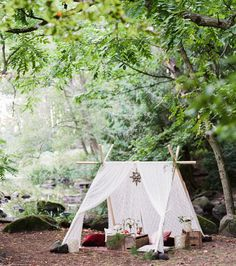 Engagement photos with a tent in the woods