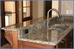 Looks just like real granite! The granite-like film goes right over old counter top...might try this....