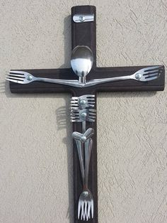 Handmade wooden cross with silverware Jesus