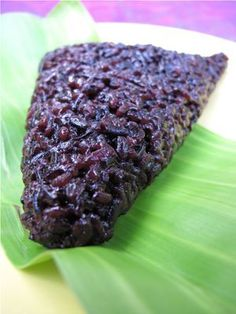 Biko  - (Purple) gelatinous rice, coconut milk, sugar     Steam 4 cups black and 4 cups white glutonous rice. Syrup coconut milk, salt, lemon rind and brown sugar in large wok. When small bubbles appear, gradually add rice. Mix, lower heat. Place in banana leaves to cool. Sprinkle with latik.    Latik - stirfry grated fresh coconut, stirfry till only the residue is left.