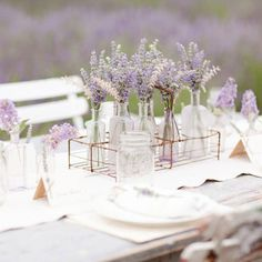 Lavender as garden party centerpieces... can put the glass vases into metal containers to give a hint of the industrial look you loved from the roost vases