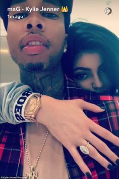 Happily ever after: Kylie Jenner shared a Snapchat video while leaning on her rapper beau's shoulder with her arm across his chest