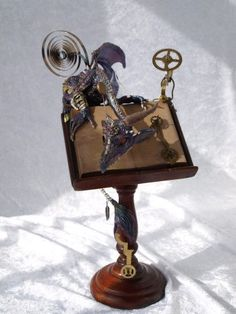 steampunk dragon on book stand by Dreamkeeperfae on etsy