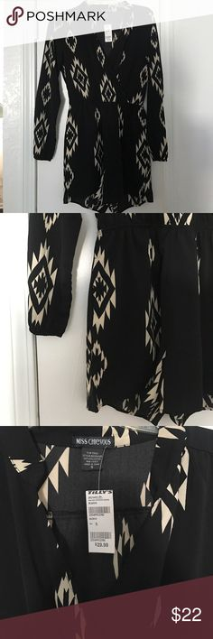 Black romper Black romper with beige color designs Tilly's Other