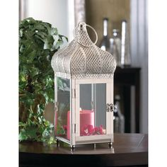 The captivating design of Morocco will add some international flair to your candle with this exotic dome lantern. Clear glass panels let the light shine through, topped with an ornate domed roof and oversize hanging loop. https://superwholesaler.com