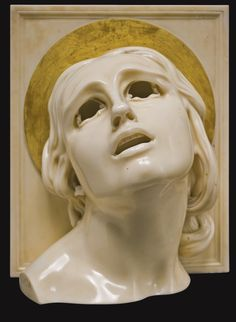 Adolfo Wildt (1868-1931), SANTA LUCIA; partially gilt Candoglia marble…