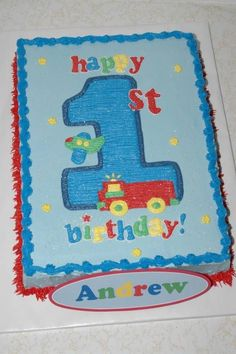Boys First Birthday Cake - 1/2 sheet cake made to match invitations.  All buttercream, design transferred via pin-prick method.  Keepsake foam placque with birthday boy's name on it.
