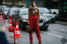 Every little detail behind all my outfits from Paris Fashion Week, including these crazy good red pants and those purple over-the-knee sock boots.