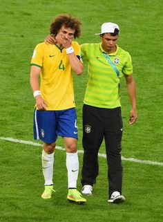 Thiago Silva of Brazil consoles David Luiz after Germany's 7 to 1 victory