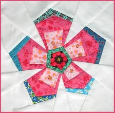 Rockrose paper pieced free pattern.  great tut on Y seams on her blog http://bubblestitchquilts.blogspot.com