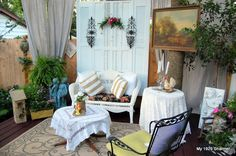 privacy screen made out of old shutters. provides privacy on our cottage stye deck seating area