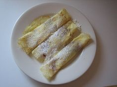 Palacinka or Palachinka – Czech, Slovak, Croatian style Crepes.  Also Palachink,  Blini, Blintzes, Crepes,  All use same ingredients except Hungarian, Russian and some Bulgarian recipes use Oil instead of butter.  Wojapi is great rolled with some whipped cream or sprinkled with powdered sugar.  Kids just like, jam, jelly and Nutella it seems!