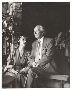 Wright in his 70s. Olgivanna in her 40s. Circa 1940s (1935-1945). Frank Lloyd Wright and his wife Olgivanna seated together at Taliesin