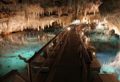 Crystal-Cave-Bermuda, Situated on the island of Bermuda this compelling cave features a 55-feet deep blue underground lake. At the bottom of the lake are a diverse variety of stunning crystal formations. As the water is so translucent, visitors can view these beautiful natural entities at their leisure – Quite simply a must for crystal aficionados everywhere.