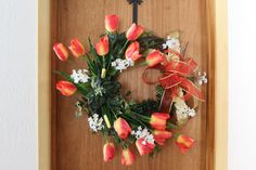 ***2017 NEW YEARS SALE - 17% OFF ALL ORDERS OVER $50.00. JUST USE COUPON CODE (2017 NEWYEARSPECIAL) AT CHECKOUT TO RECEIVE YOUR DISCOUNT.***  This wreath is perfect for your house décor collection. It is created on a grapevine base and is completed with various silk flowers including, tulips, ivy, and a ribbon. This wreath is ready to ship and will be shipped 1-2 business days after purchased.  Dimensions of this wreath: 30 in diameter and 8 deep   *This wreath was created on a 18 grapevine…